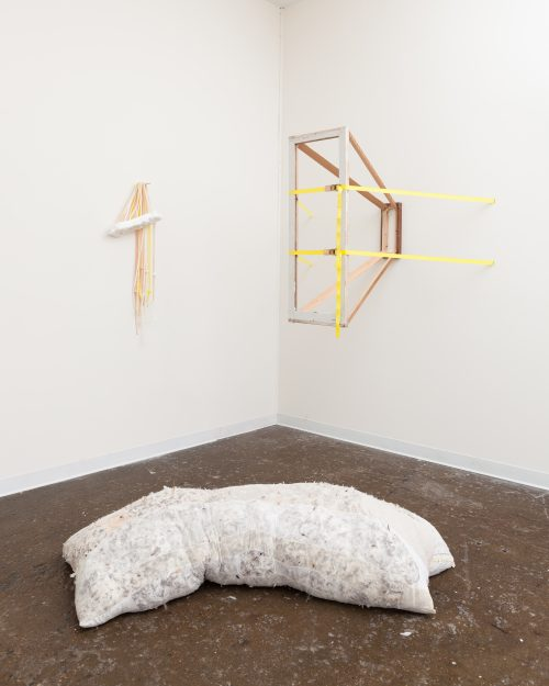 punch toys 2016  wood, straps inserted into and around wall, cast foam, cast rubber, nylon stockings, down feathers